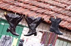 Stock Photo of Wet shoes hanging