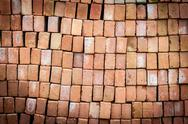Stock Photo of wall of new red bricks stacked in rows.