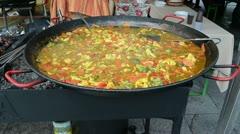 Healthy diet food vegetable stew huge pan outdoor street event Stock Footage