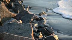 High tide reaches rocks on shoreline - stock footage