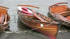 Rowing boats for hire on Lake Windermere on a rainy day Stock Footage