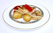 Stock Photo of fish fillet with vegetables and potatoes