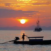 longtail boats  at sunset, thailand - stock photo