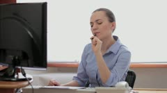 Portrait of a thinking businesswoman HD Stock Footage
