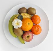 Healthy fruits on plate Stock Photos