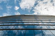 Stock Photo of glass building in the sky