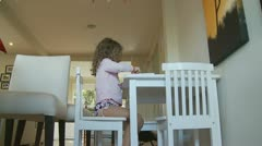 Dolly in & out, young girl drawing - model release Stock Footage