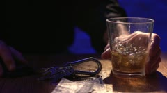 Man finishes his alcoholic drink and then takes his keys to drive Stock Footage