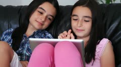 happy teenage girls having fun using touchpad computer - stock footage