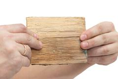 wooden board sign on hand isolate on white - stock photo