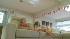 Dolly shot, two children watch TV (7) model release Stock Footage