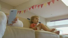 IPhone user & little boy dolly shot (1) model release Stock Footage
