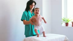 Nurse playing with a baby in hospital Stock Footage