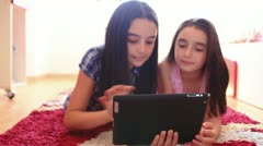 Two happy teenage girls using tablet computer - stock footage