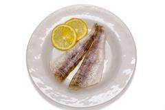 Raw fish filets with lemon - stock photo