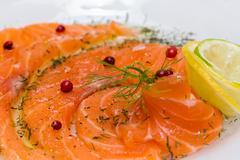 Salmon carpaccio with pink pepper Stock Photos