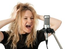 Rock singer screaming to the microphone Stock Photos