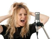 Stock Photo of Rock singer screaming to the microphone
