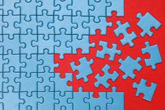 concept missing pieces in a puzzle - stock photo