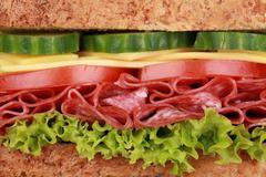 Closeup of a sandwich with salami Stock Photos
