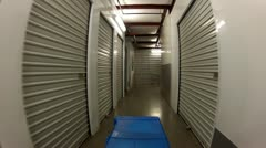 Footlocker Down Hallway Past Personal Storage Units To Elevator Stock Footage