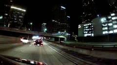 Driving 110 Freeway North Past Downtown Los Angeles Skyscapers- Night Stock Footage