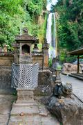 traditional balinese house of spirits near waterfall - stock photo