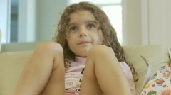 Little girl watching TV (mid shot) model release Stock Footage