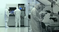 Scientists / Technicians Working in Clean Room, Wide Shot Stock Footage