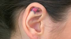 Extreme close up of tattoo in ear Stock Footage