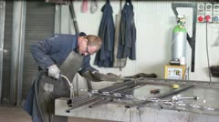 Worker welding in a factory Stock Footage