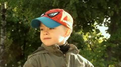 Child wearing a spider man hat Stock Footage