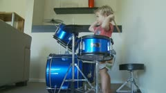 Dolly in & out  young boy playing drums (4) model release Stock Footage