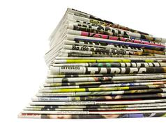 Stacked colour newspapers Stock Photos