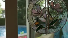 Scenes from the Suburbs - a stained glass chime hanging in a doorway. Stock Footage