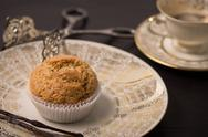 Vegan muffin on antique plate. Stock Photos