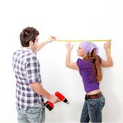 Home improvements, couple with drill Stock Photos
