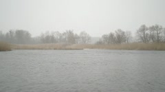 Type on the winter river with a falling snow Stock Footage