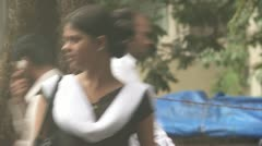 Woman crossing the road in Mumbai Stock Footage