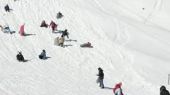 Kids Sledding Children Playing Sledging Mountain Snow Winter People Families Fun - stock footage