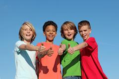 group of divderse kids at summer camp with thumbs up - stock photo