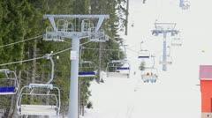 Ski resort, chair ski lift elevator lifting people Stock Footage