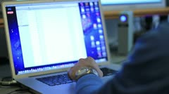 Man using a laptop Stock Footage