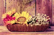 Stock Photo of vintage image of flowers on a basket