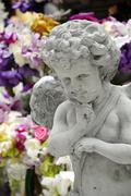 statue of cupid - stock photo