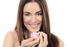 Stock Photo of beautiful woman with pink rose