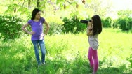 Cute little girls making photo session in summer Stock Footage