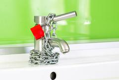 locked water faucet - stock photo