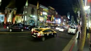 Stock Video Footage of Wide Angle Hollywood Blvd Traffic And Tourists- Night