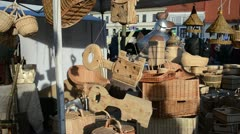 Various wooden wicker decor objects sold outdoor market fair Stock Footage